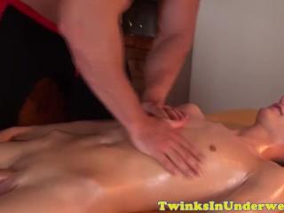 Stud masseur tugs on twinks huge dick