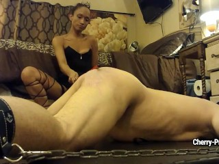Slim mistress hits her enchained slave man with black stick