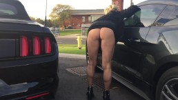 MILF SHOWING TANNED BUBBLE BUTT & PUSSY IN BUSY CAR LOT