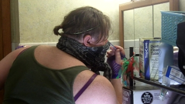 Crossdressing Emo Sissy puts on her own eye makeup for the first time
