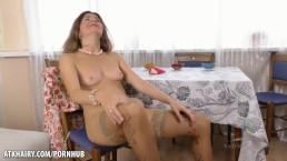 Hairy Housewife masturbates on kitchen table