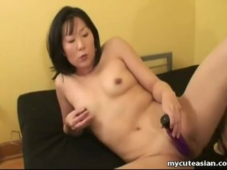 Beautiful Asian wife enjoys toying her shaved twat all alone