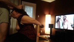 Amateur sub, with arms tied behind chair, has her mouth used and abused