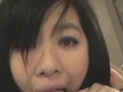 Long haired Asian beauty sucks a big boner in POV
