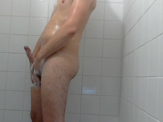 Twink showers with clothes and shoots cum