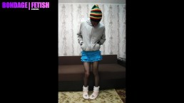 Boy in blue skirt and fishnet tight, slipper socks