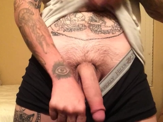 Tatted uncut stud shows off soft cock