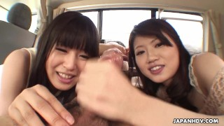 Two adorable Asian teen hitchhikers suck cock in the car Amateur blowjob