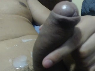 Guy masturbating and cum stomatch on couch