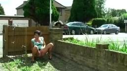 Girl is pissing outdoor