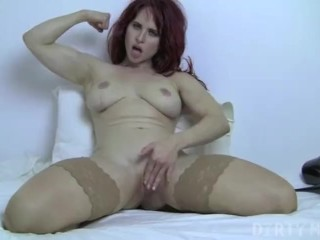 Redhead on the bed stroking her pussy