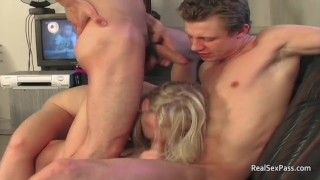 Two guys fucking together with a female