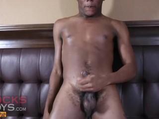 Twink bottom strokes his dick and busts a hot load