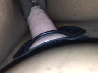Close up of her taking that strap