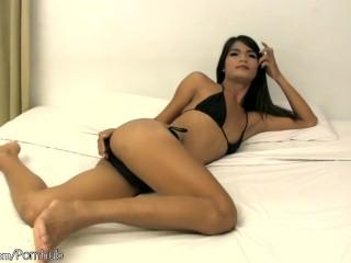 Feminine doll with balls flashes tiny tits from black bikini