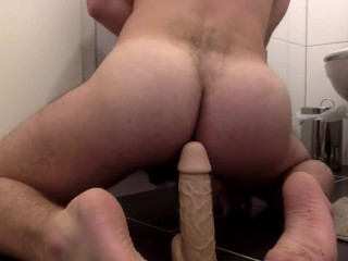 bottom fucked by own dildo