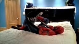 spiderman having fun with his toy skeleton