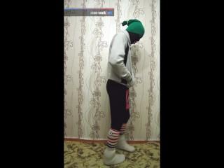 Encased in pants and hoodie in slipper socks
