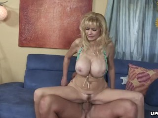 Massive tits blonde rides a cock like a sex phenom
