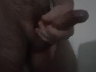 Man masturbating hard and cumming a big load