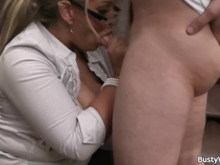 Busty woman at work spreads legs for him