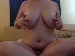 Curvy girl massages big tits and plays with her own nipples!