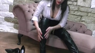 Sexy secretary babe slowly pulls on her leather thigh boots over her nylons porno