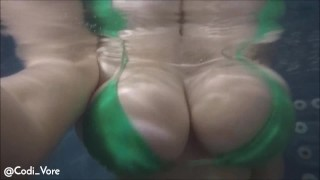 Screen Capture of Video Titled: Codi Vore Plays with Huge Tits Underwater