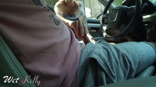 Hooker giving handjob in the city streets while a lot of car passing by