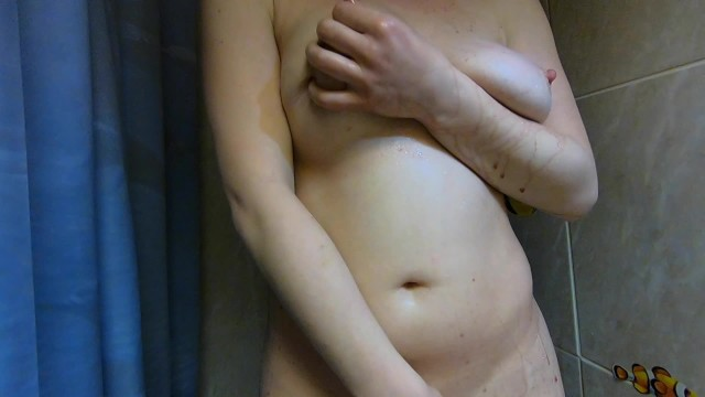 Beautiful Ginger Teen Teasing Large Natural Breasts Pouring Red  on it 12