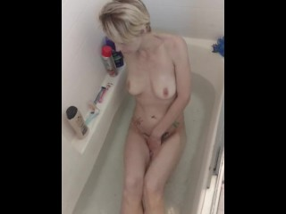 Skinny short haired wife teasing in the bath