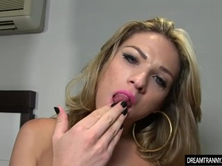 Shemale Luana Pacheco gets her dick hard and pees