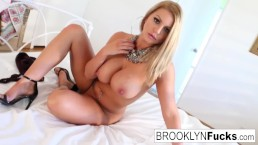 Pornstar Brooklyn puts a purple toy in her pink pussy