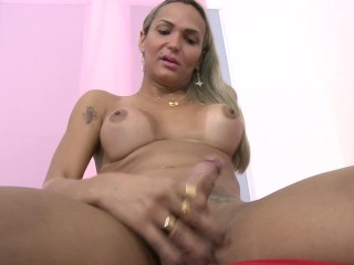 Curvy blonde shemale Erika Sampaio strokes her amazing cock