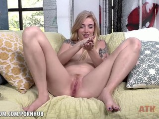 Hot blonde Melissa Rose using a purple toy on her pussy