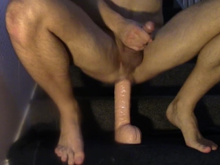 Riding big dildo and cumming