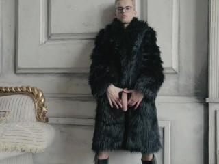 Blond fur coat shows his long uncut cock...