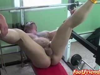 Tattooed hunk Ronnie J tied up inside the gym and tickled