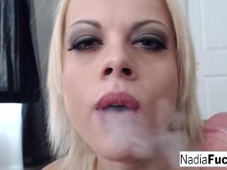 Nadia smokes an e-cig while also smoking a pole