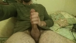 Jerking off in bed with cum