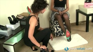 Lesbians in a shoe store