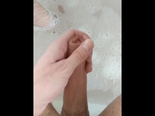 Big, uncut dick going soft to hard in the bath
