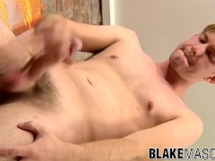 Fit stud plays around with his big hairy cock on the sofa