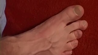 Handsome stud playing with his feet and slowly jerking off Gay cum