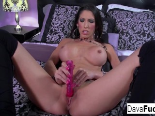 Solo on bed with a pink toy