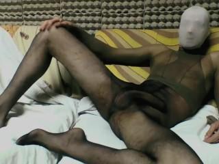 YOUNG GUY IN BLACK AND TAN PANTYHOSE ENCASEMENT MASTURBATING