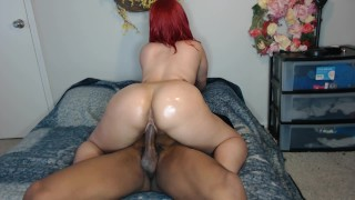 Screen Capture of Video Titled: Thick ass red head ride's cock w/ perfect ass & make's friend cum fast!