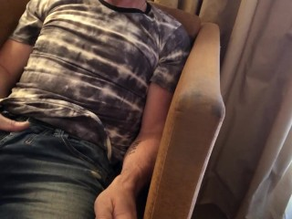 Pulling out bulging cock from jeans and stroking