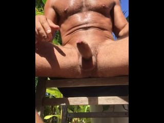 Wanking and blowing my load in the sun