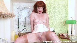 Redhead Zoe Page teases and strips showing off nyloned legs and bare pussy